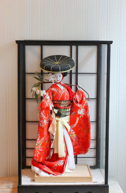 small geisha doll on display