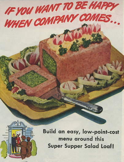 1950s recipe idea marketing mayonnaise, showing a square loaf of spam stuffed with a green paste.